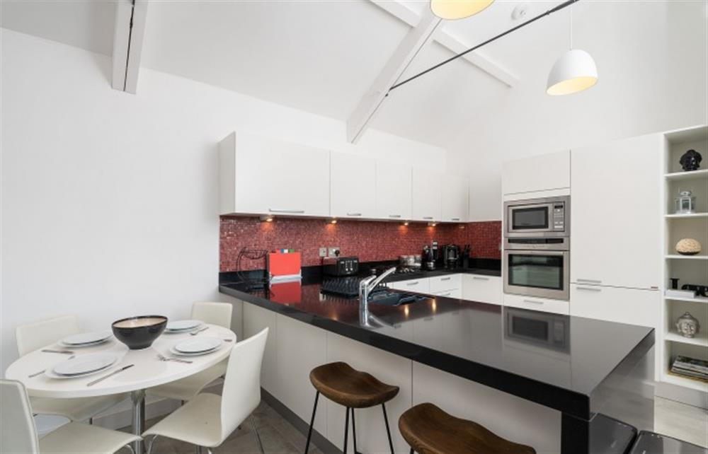 The dining area and superbly-equipped kitchen at 4 Bouchard, East Allington