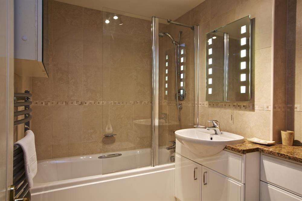 Modern, fully-tiled family bathroom at 4 Dartmouth House in , Dartmouth