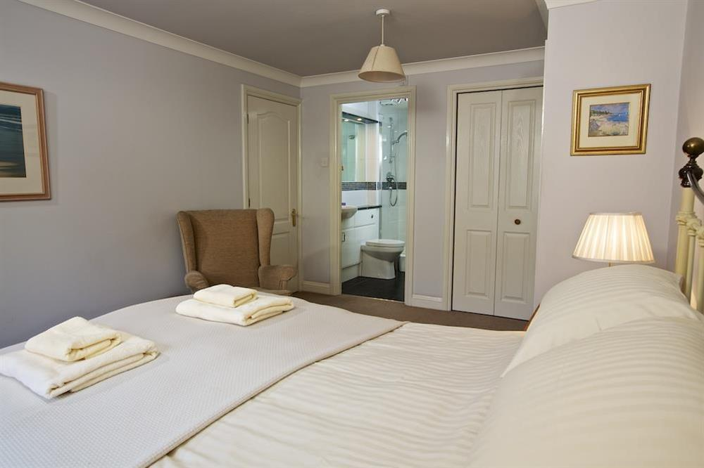 Spacious master bedroom with King-size bed and en suite at 4 Dartmouth House in , Dartmouth