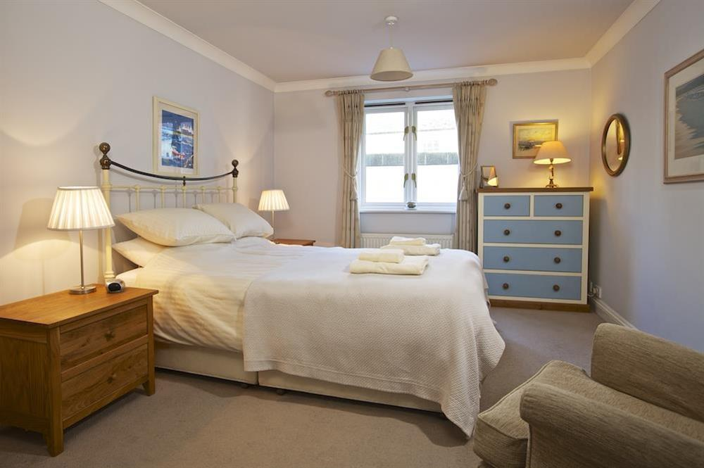 Spacious master bedroom with King-size bed at 4 Dartmouth House in , Dartmouth