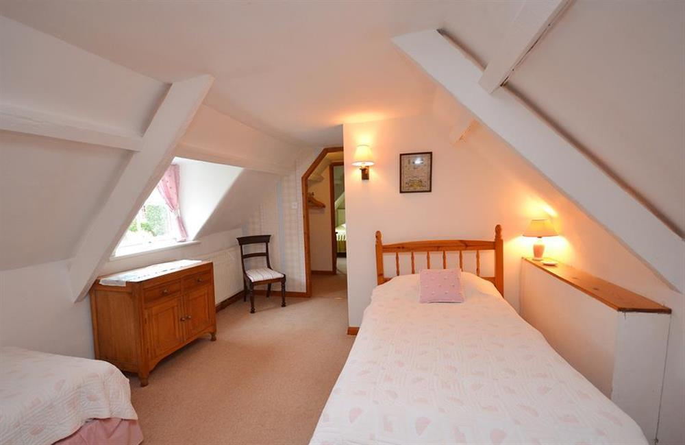 An attic bedroom leading through to a 2nd bedroom and shower room at 4 Kings Quay, Dartmouth