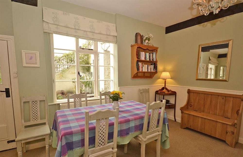 The dining area with door out to the patio at 4 Ramparts Walk, Totnes