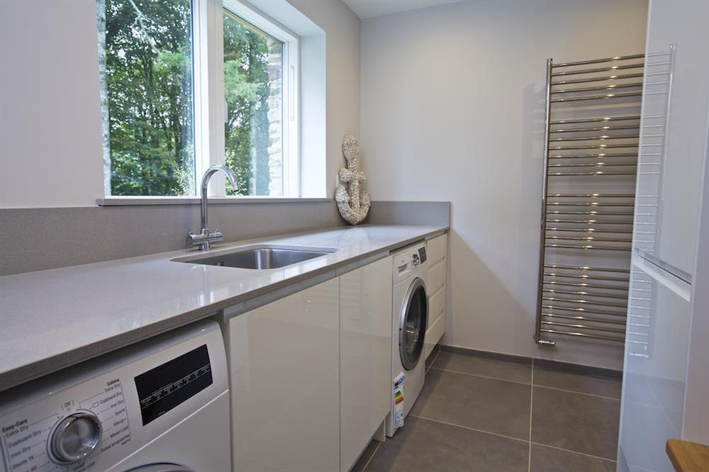 Utility room with washing machine and tumble dryer