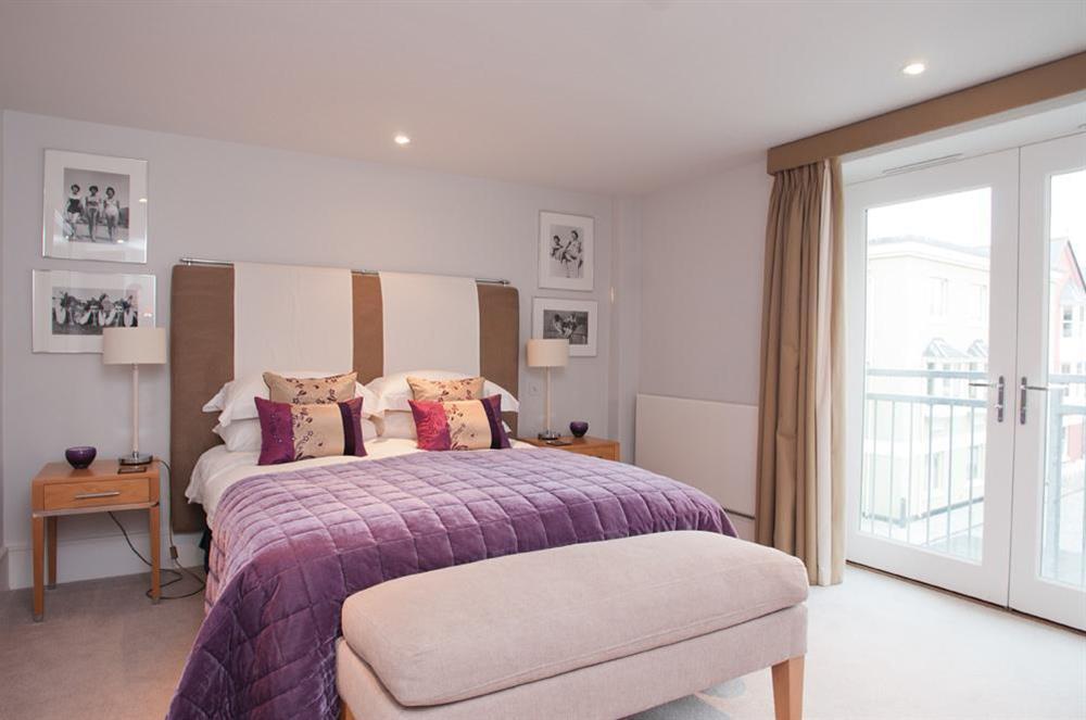Master bedroom with King-size bed and river views at 45 Dart Marina in , Dart Marina