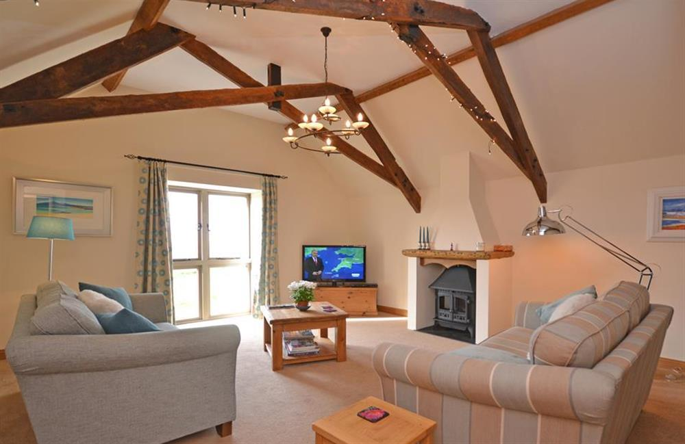 The bright and cosy lounge at 5 West Hartley Barns, Blackawton