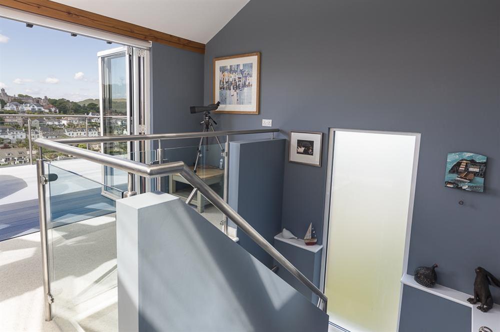 Bi-folding doors out to upper balcony