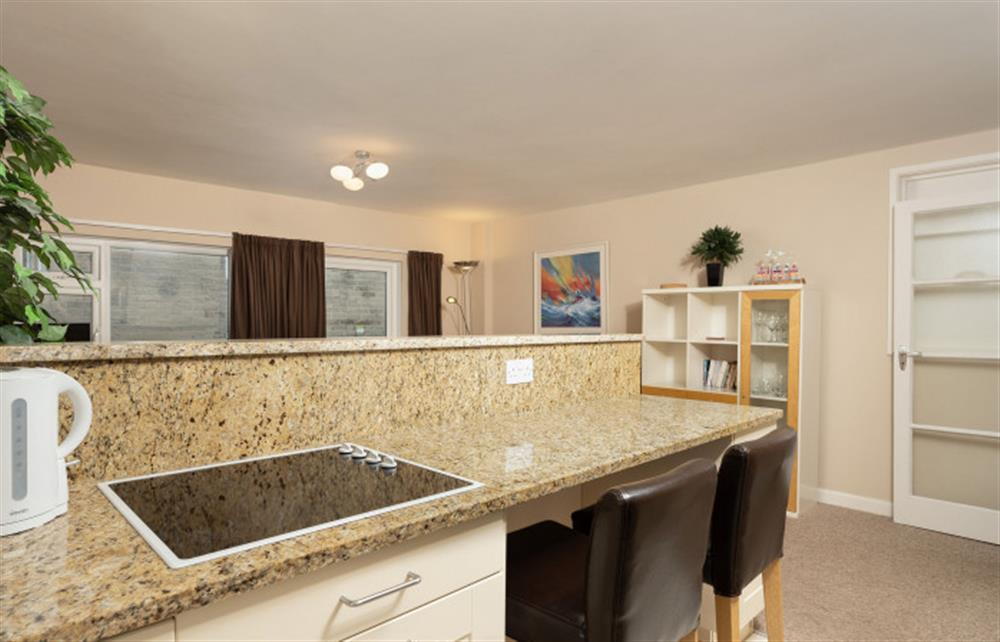 The open plan living space enjoys a social breakfast bar area. at 6 Lee Court, Dartmouth