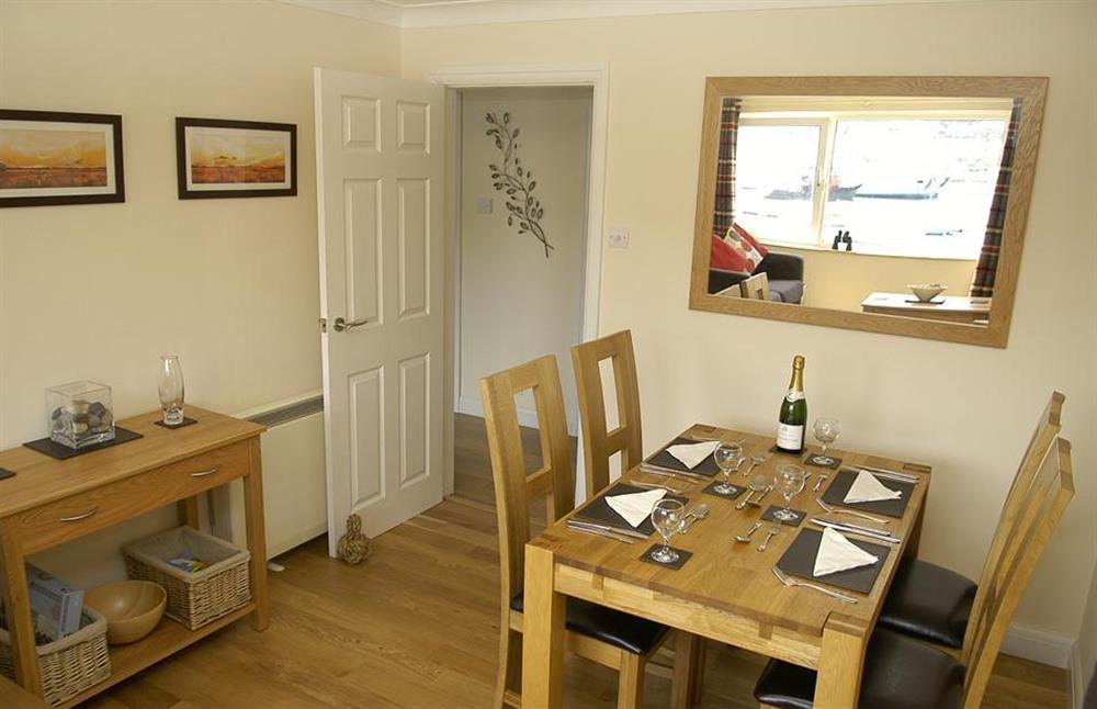 The dining area with oak dining table and chairs at 6 Mayflower Court, Dartmouth