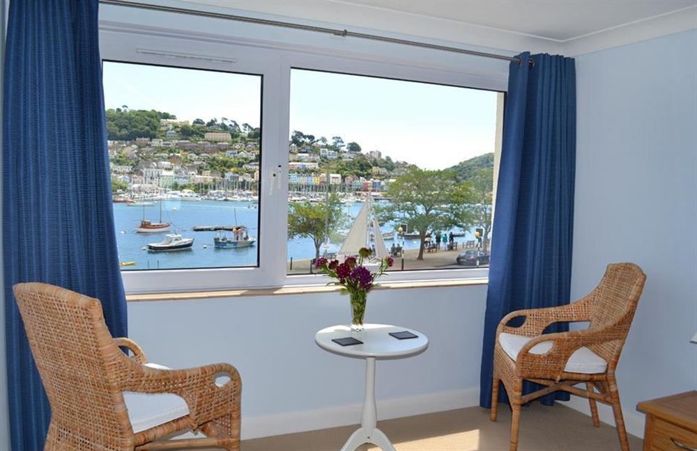 The seating area in the double bedroom with views of the estuary at 6 Mayflower Court, Dartmouth