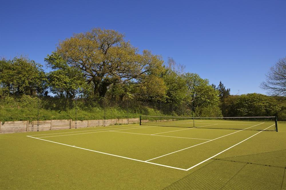 All weather tennis court at 6 The Manor House, Hillfield Village in , Hillfield, Dartmouth
