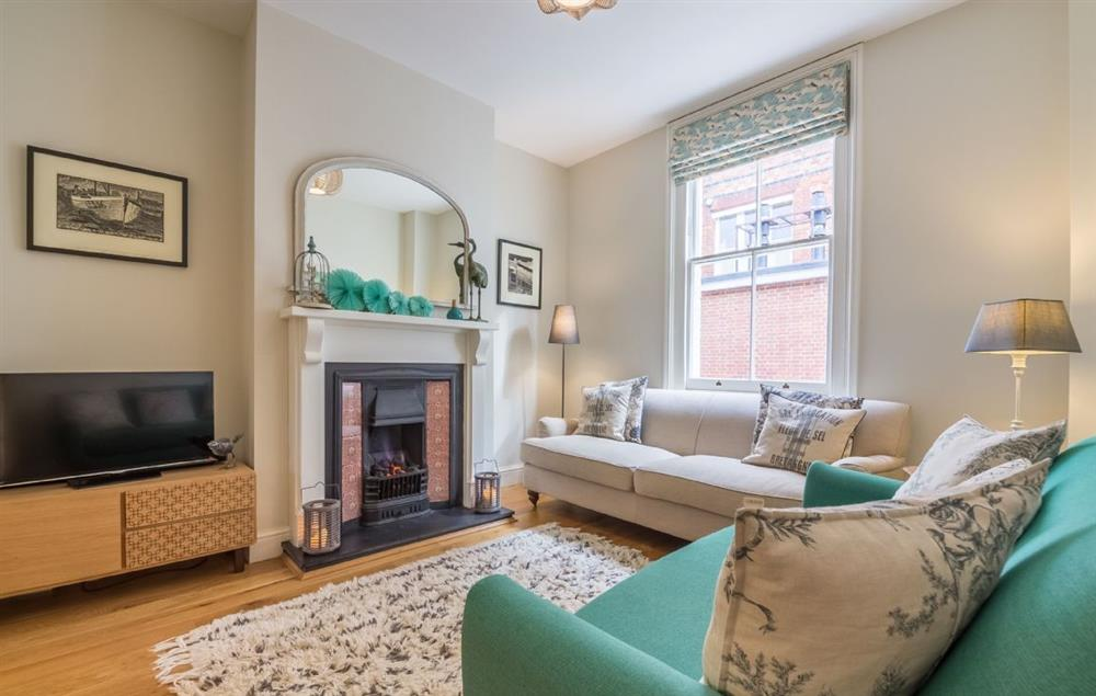 Ground floor: Sitting room with coal effect fire at 7 Brudenell Street, Aldeburgh