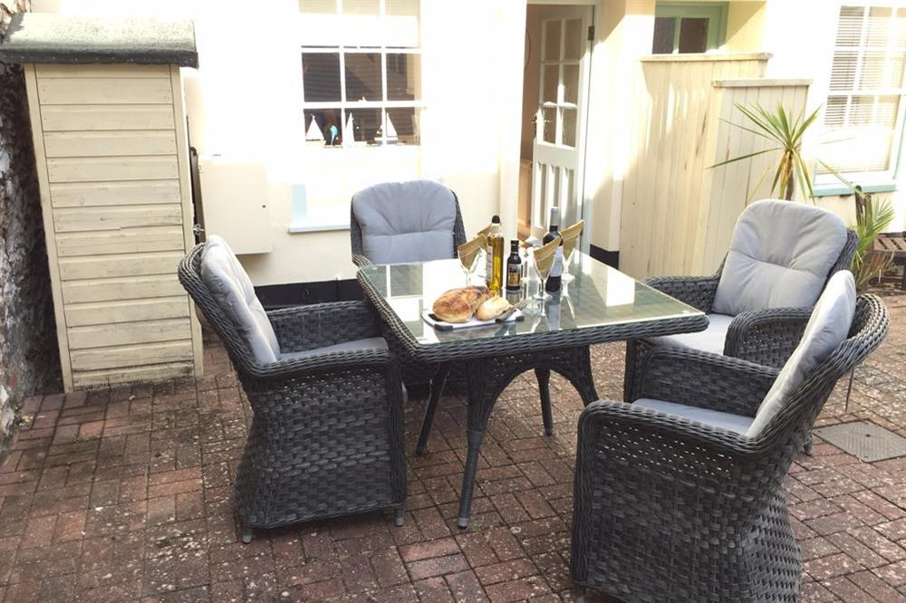 Furnished patio to rear of the property