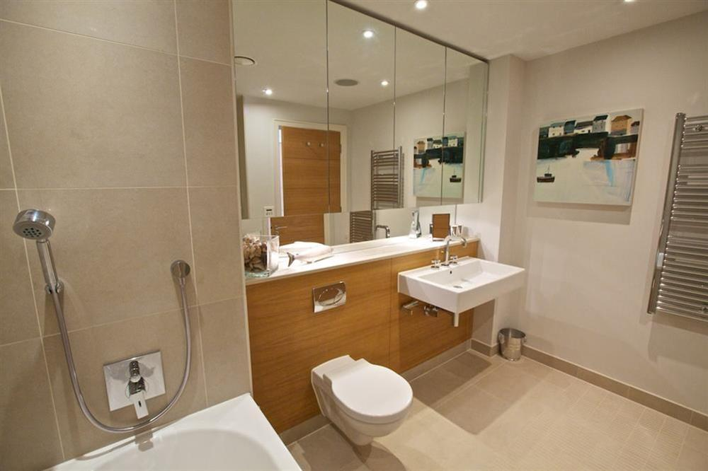 Beautiful, fully-tiled en suite bathroom with Kaldewei bath and separate shower at 7 Dart Marina in Sandquay Road, Dartmouth