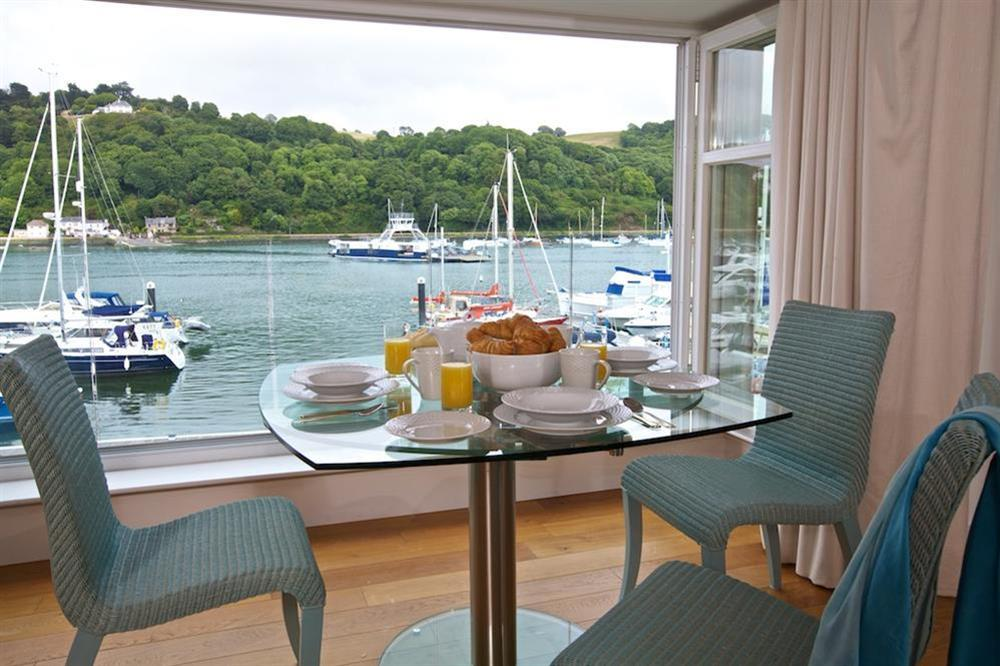Glass dining table with four chairs at 7 Dart Marina in Sandquay Road, Dartmouth