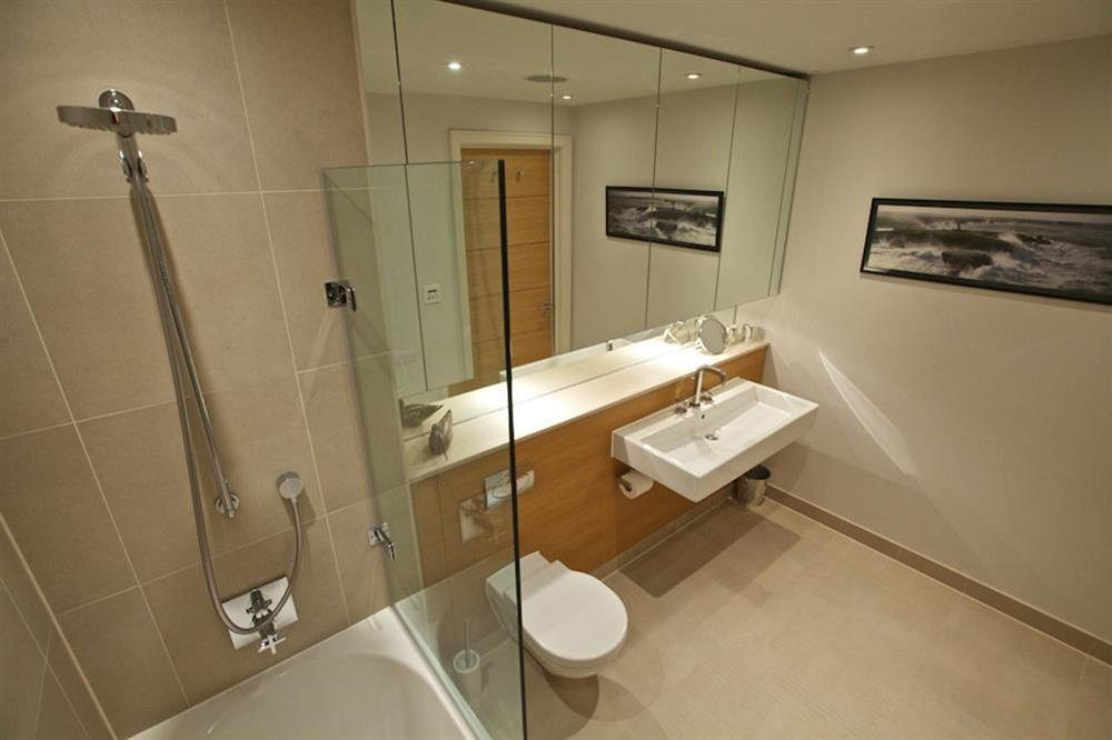 Lovely family bathroom (opposite the twin bedroom), with Kaldewei bath and shower (over) at 7 Dart Marina in Sandquay Road, Dartmouth