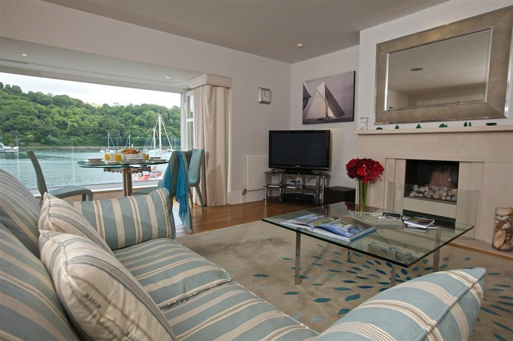 Stylishly elegant lounge with glass coffee table and flatscreen TV (photo 2) at 7 Dart Marina in Sandquay Road, Dartmouth