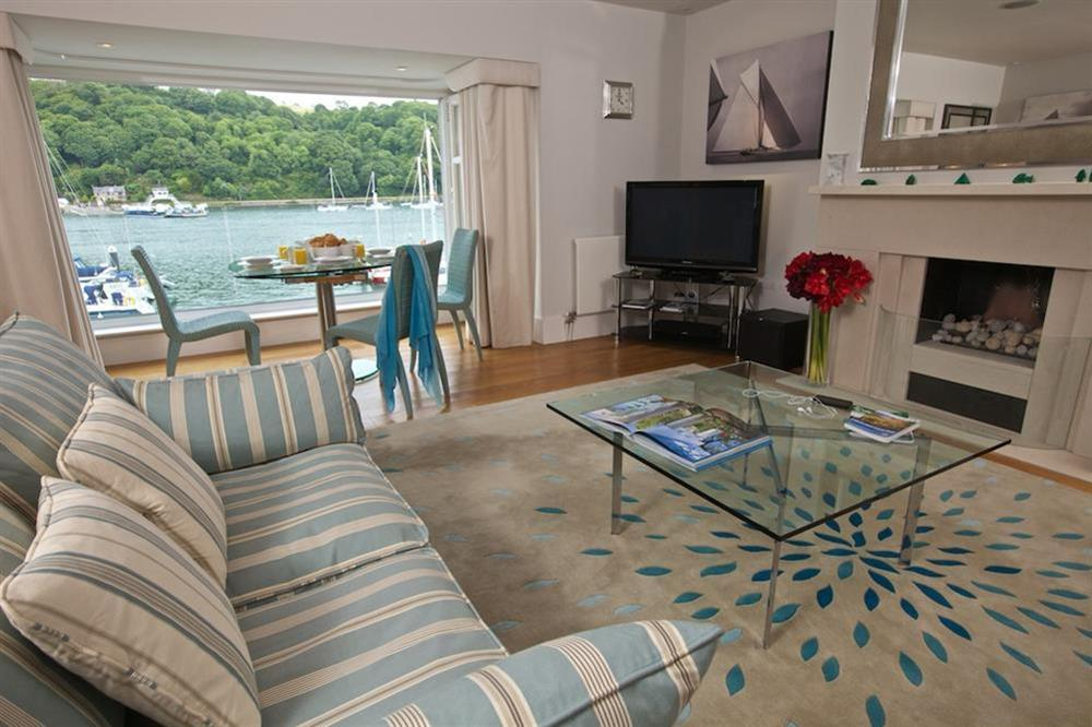 Stylishly elegant lounge with glass coffee table and flatscreen TV at 7 Dart Marina in Sandquay Road, Dartmouth