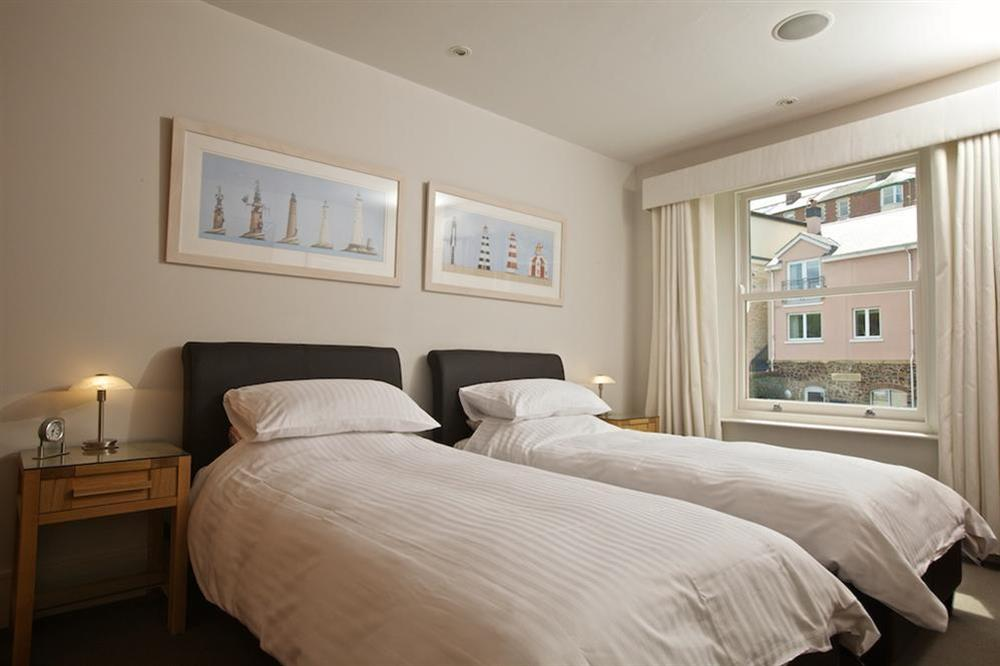 Twin bedroom with leather framed beds (photo 2) at 7 Dart Marina in Sandquay Road, Dartmouth