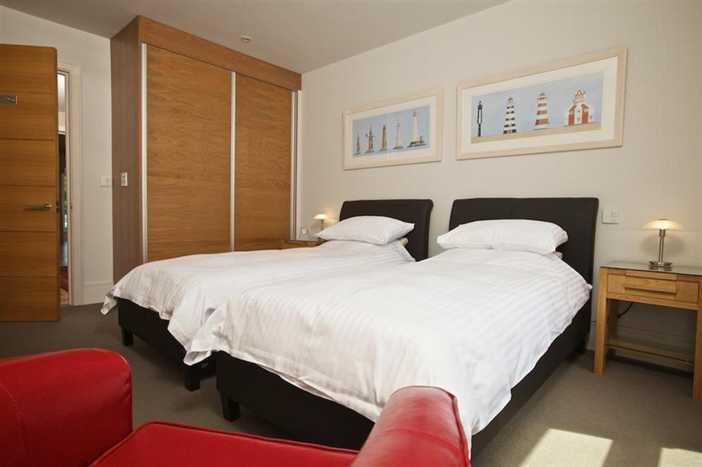 Twin bedroom with leather framed beds at 7 Dart Marina in Sandquay Road, Dartmouth