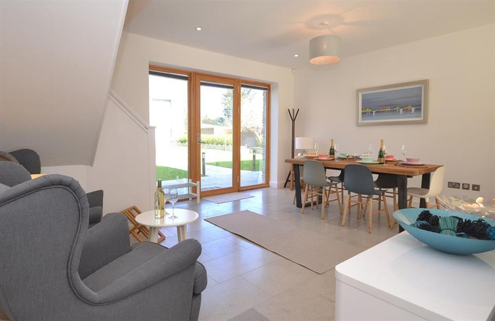 Another view of the dining area with additional seating area at 7 Dufour, East Allington