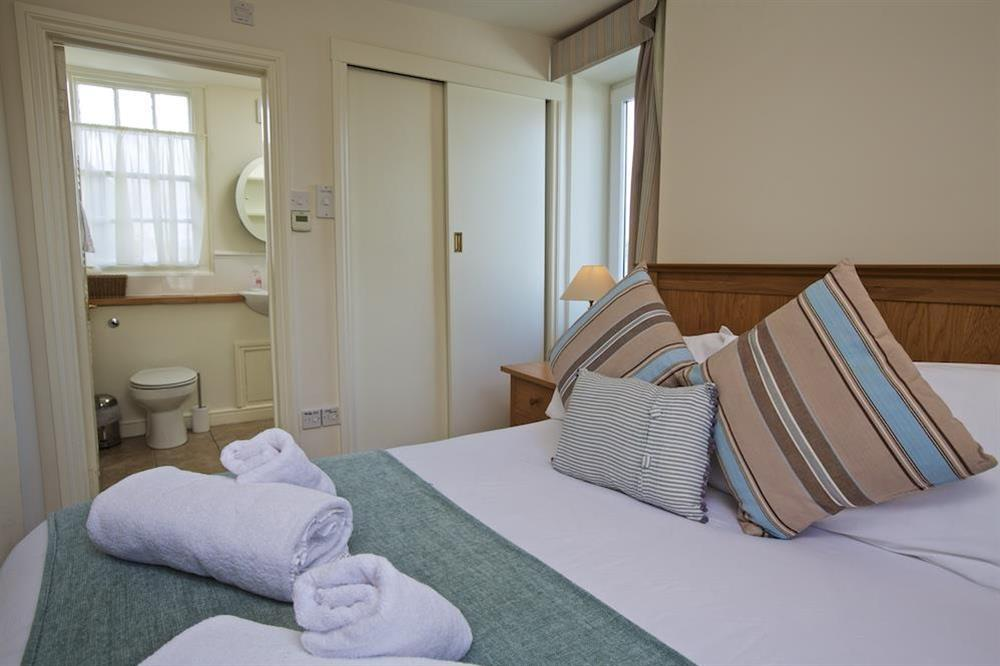 Master bedroom with king size bed and en suite (photo 3) at 7 Nelson Steps in , Dartmouth