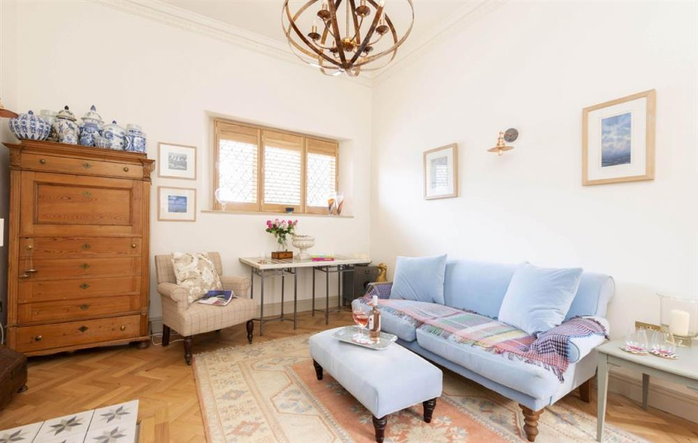 Ground floor: Spacious sitting room with comfortable sofas