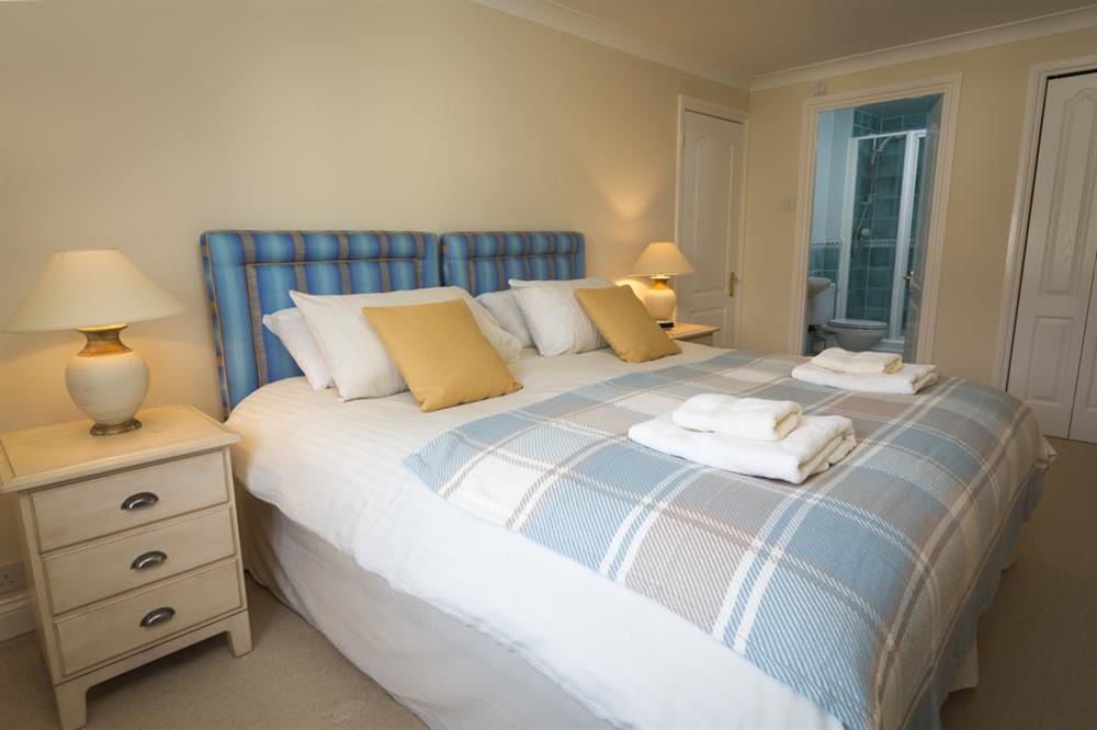 En suite master bedroom with King-size bed at 9 Dartmouth House in , Dartmouth