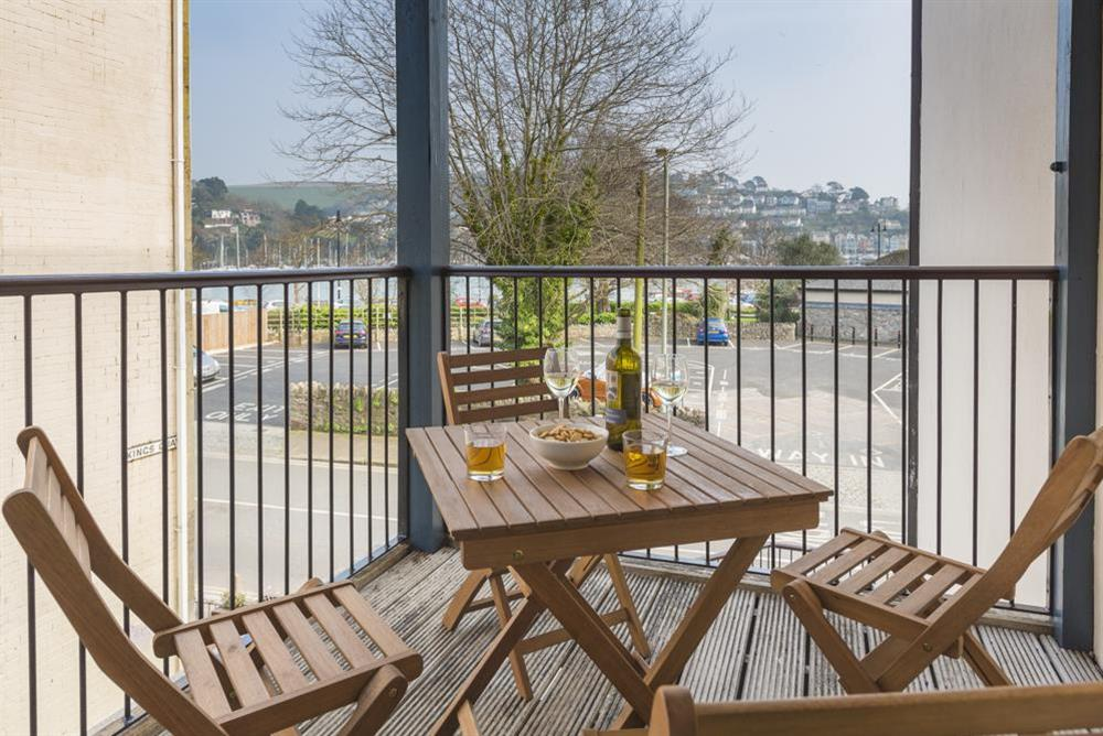 French windows lead to a furnished balcony with river views at 9 Dartmouth House in , Dartmouth