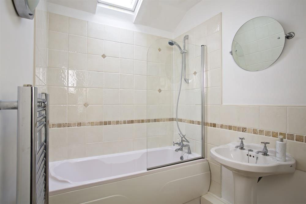 Family bathroom with bath and shower at 94 Above Town in , Dartmouth