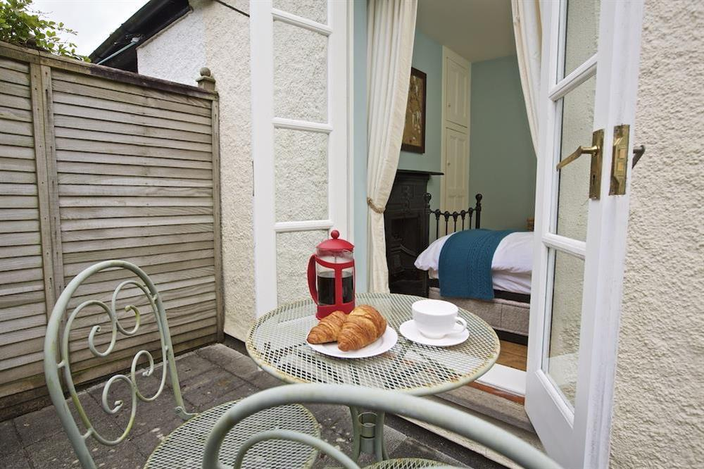Terrace with small table and chairs at 94 Above Town in , Dartmouth
