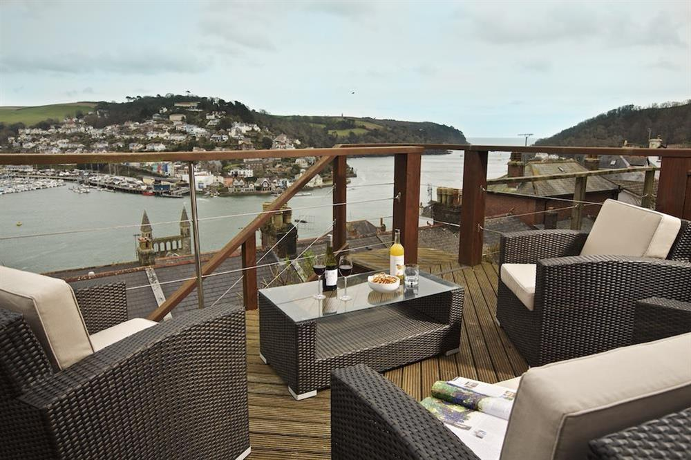 The upper decking has a beautiful set of rattan furniture and great views at 94 Above Town in , Dartmouth