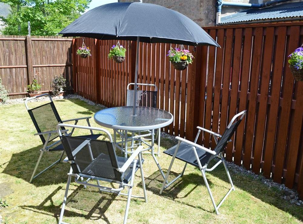 Relaxing garden with garden furniture at Acorn Cottage in Conon Bridge, Highlands, Ross-Shire