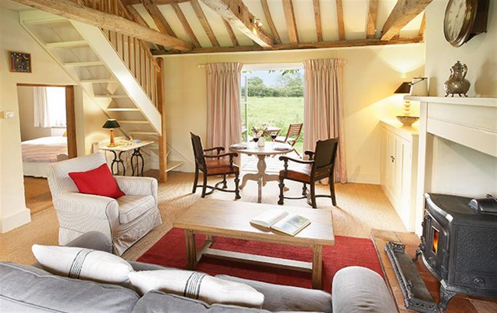 Ground floor: Sitting room with dining area at Acorn Cottage, Oulton