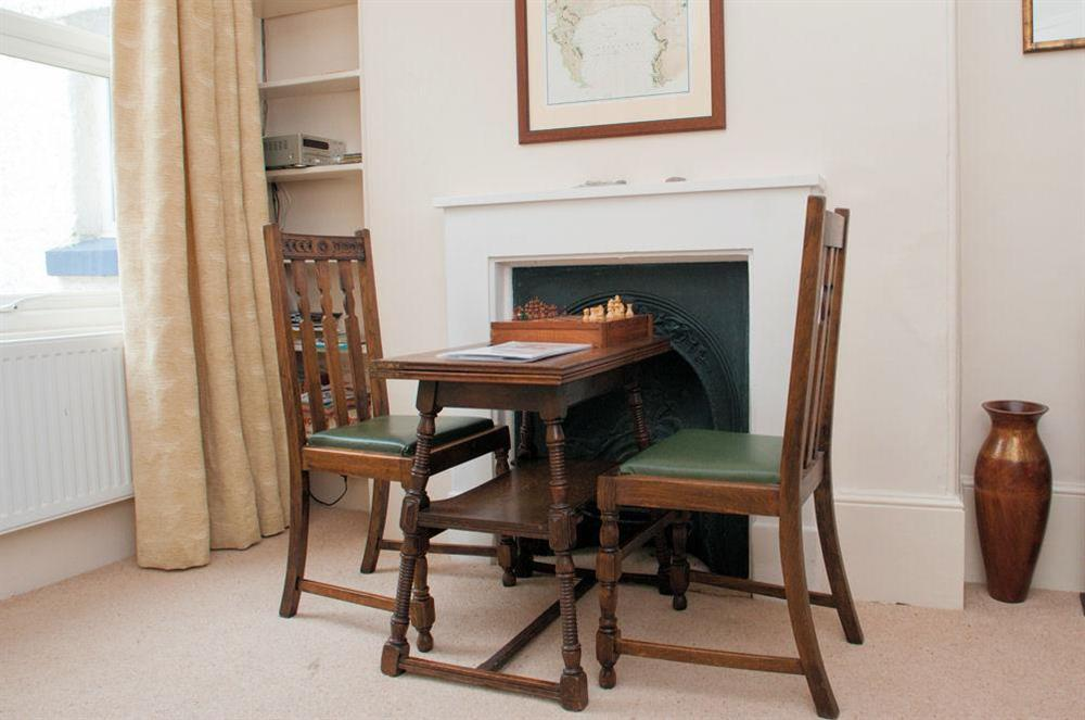 Card/reading table and two chairs at Aeolus House in 42 Newcomen Road, Dartmouth