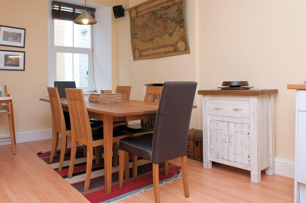 Hardwood dining table and chairs at Aeolus House in 42 Newcomen Road, Dartmouth