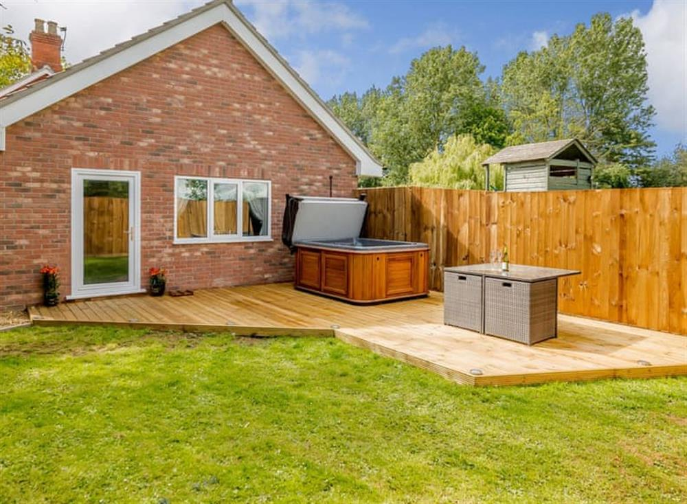 Exterior with hot tub at Alder Lodge in Yaxham, near Dereham, Norfolk