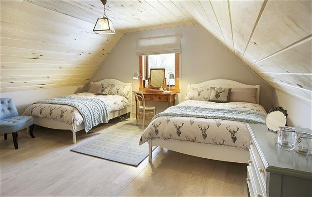 First floor: Double bedroom with two 4'6 beds at Am Bathach, Sutherland