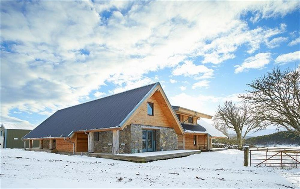 The property is surrounded by wild croft land and open skies at Am Bathach, Sutherland