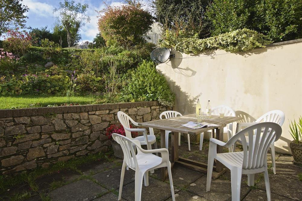 Paved terrace with table and chairs at Amberley in , Dartmouth