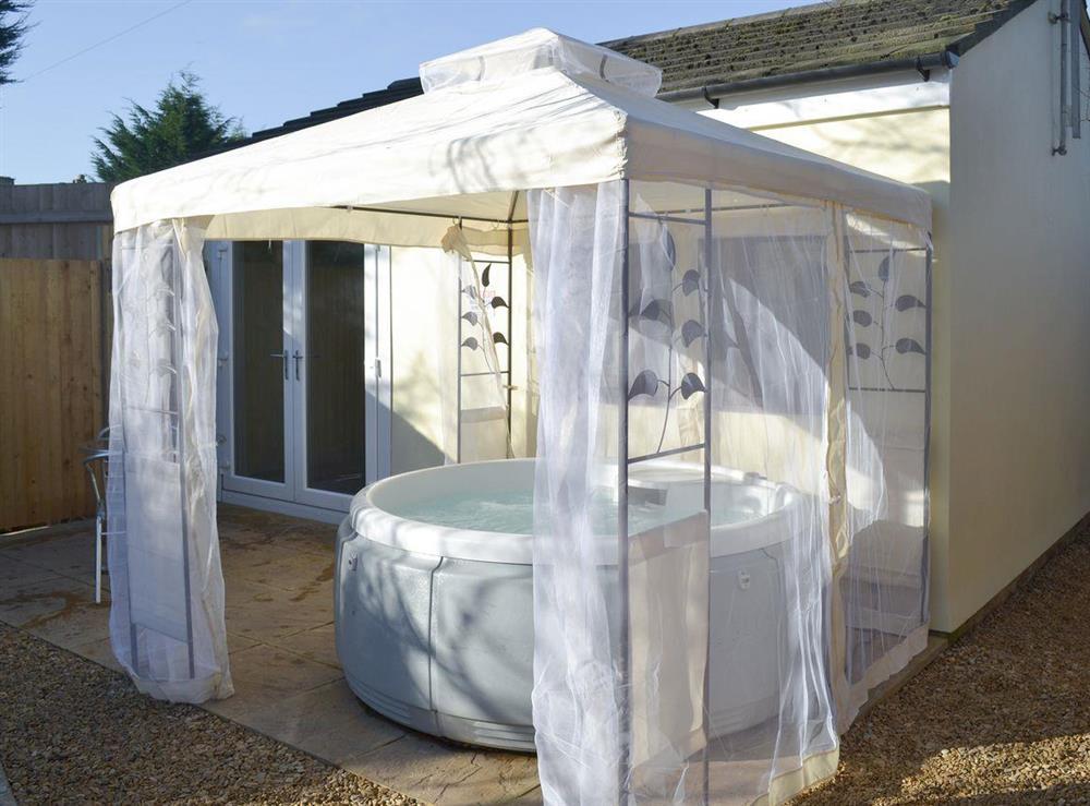 Hot tub at Amelia Cottage in Clandown, near Radstock, Avon