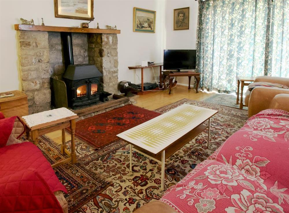 Delightful living room with wood burner at Anvil Cottage in Twyford, near Shaftesbury, Dorset