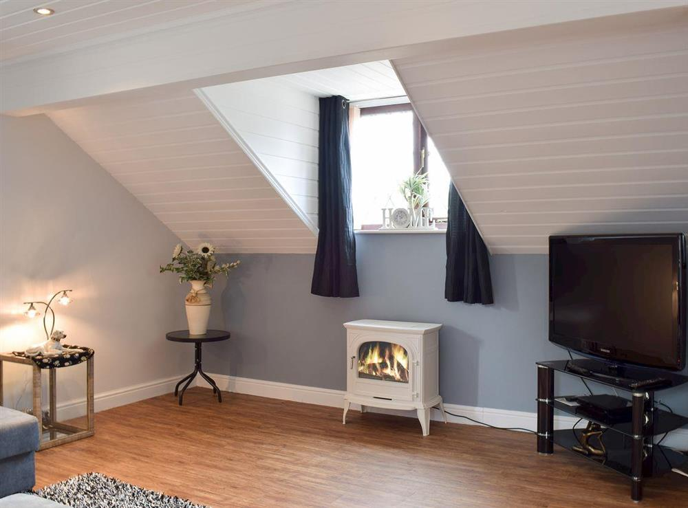 Cosy living room with TV at Appleview in Kirby Cane, near Lowestoft, Norfolk
