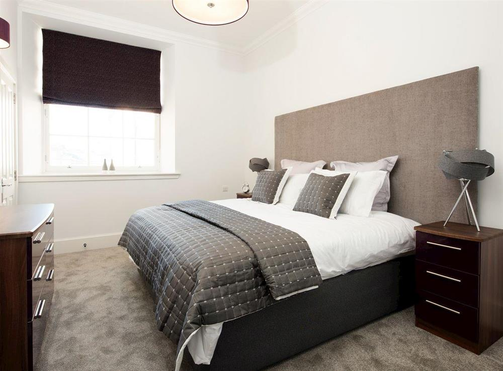 Comfortable double bedroom with en-suite shower room at Apartment 4,