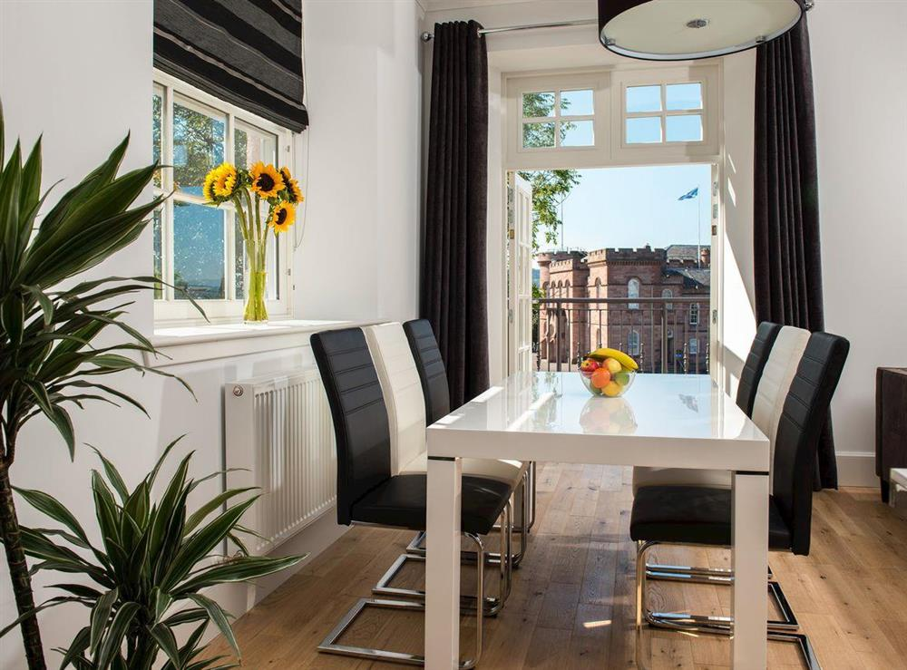 Delightful dining area with balcony access at Apartment 4,