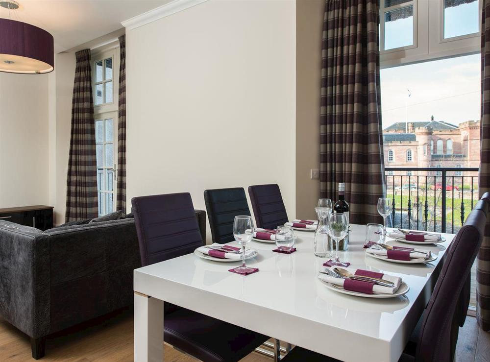 Convenient dining area with French door to balcony at Apartment 6,