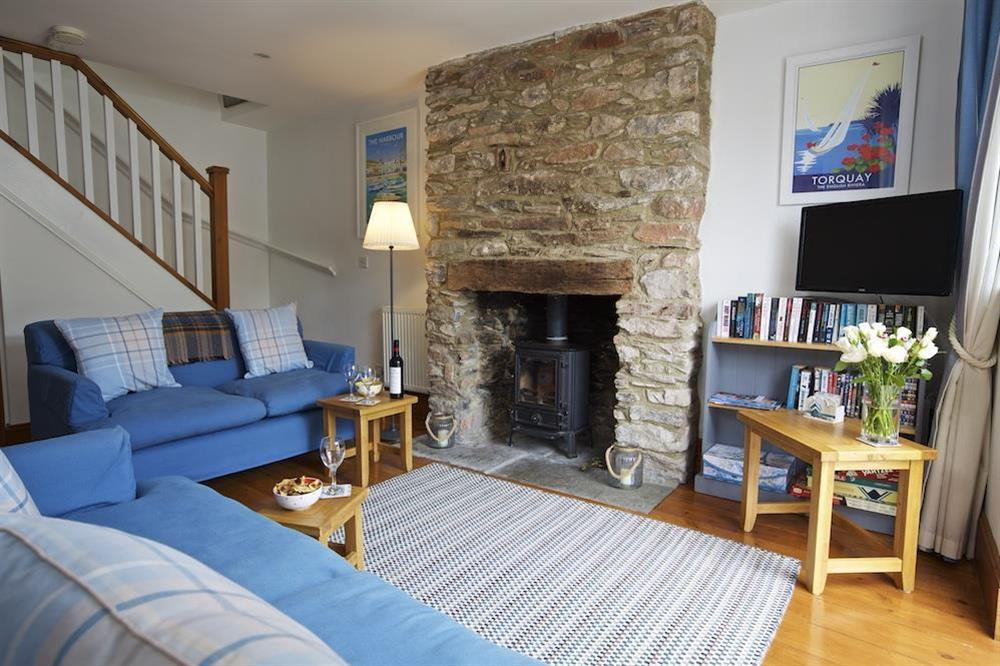 Cosy living area with woodburning stove (photo 2) at Armada Cottage in , Dartmouth