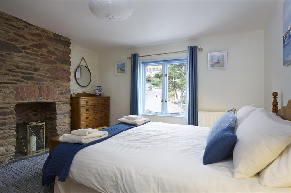 Master bedroom with king size bed at Armada Cottage in , Dartmouth