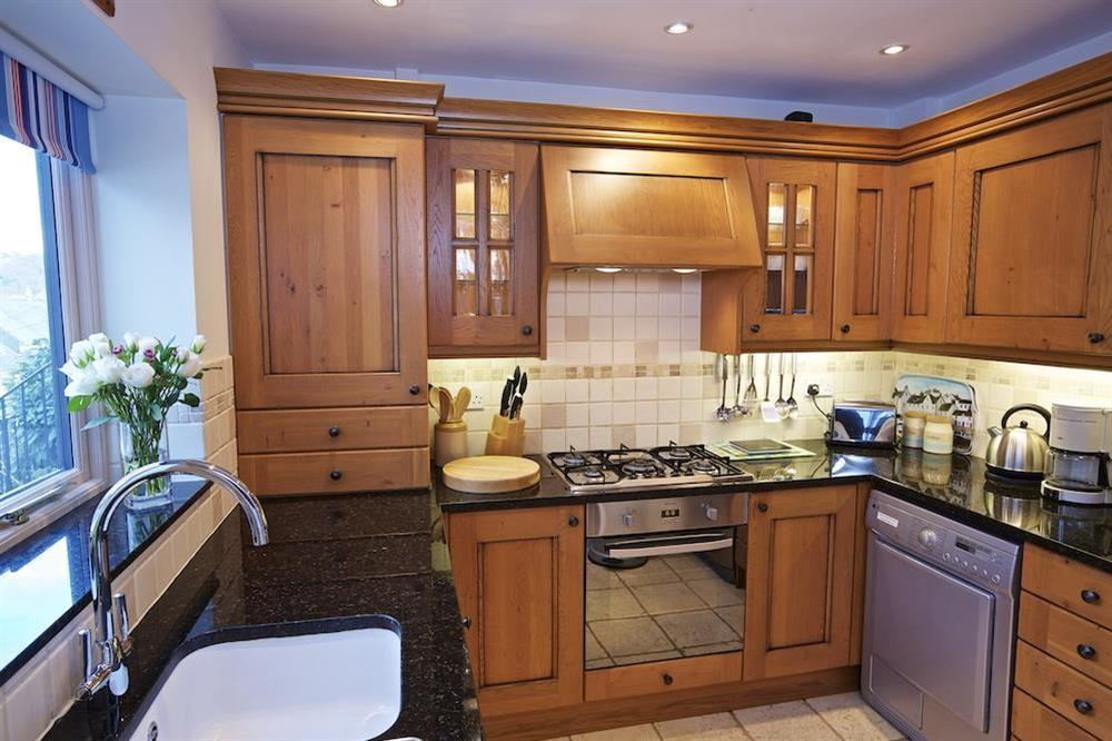 Well equipped kitchen area at Armada Cottage in , Dartmouth