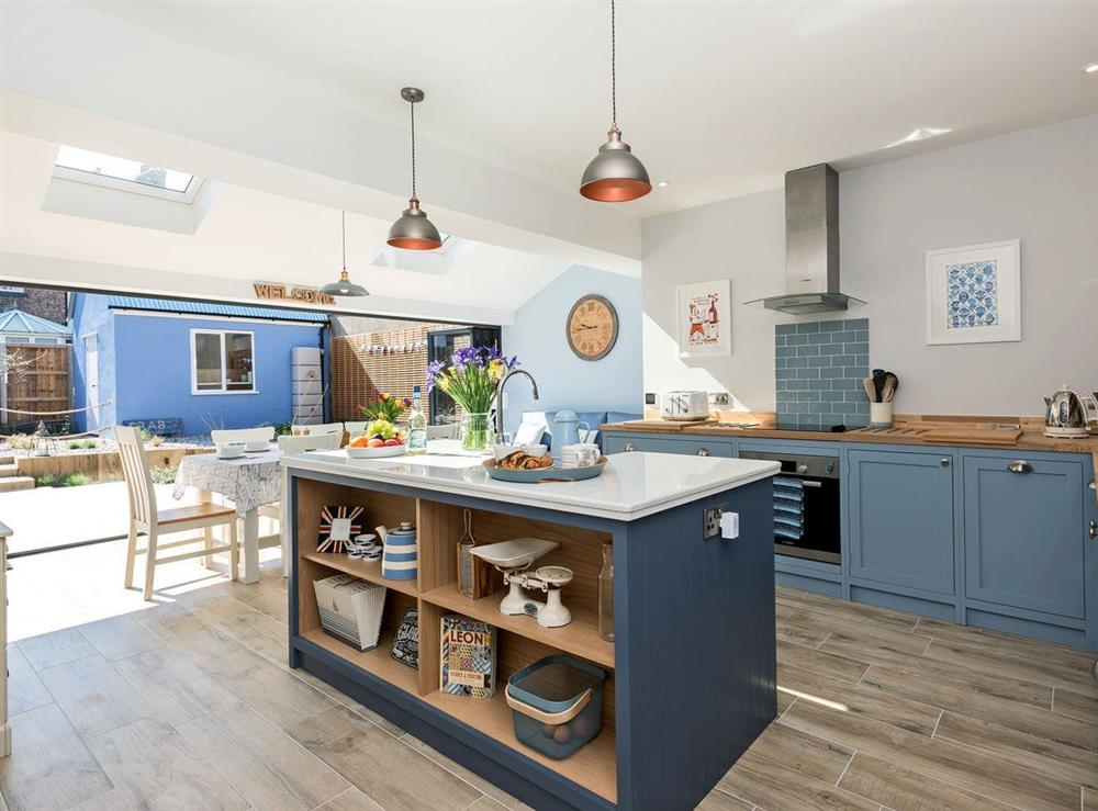 Light and airy kitchen/dining room leading to garden at Ascot Villa in Sheringham, Norfolk