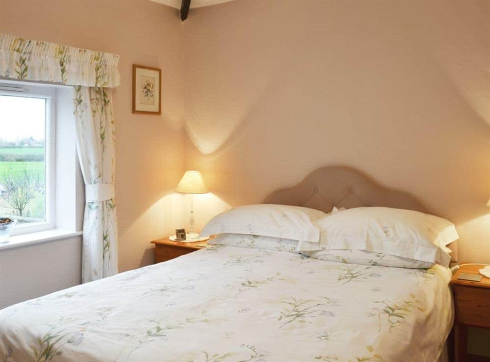 Double bedroom at Ash Cottage in Oscroft, near Chester, Cheshire